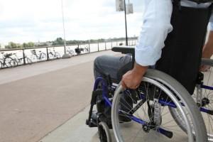man in wheelchair paralyzed